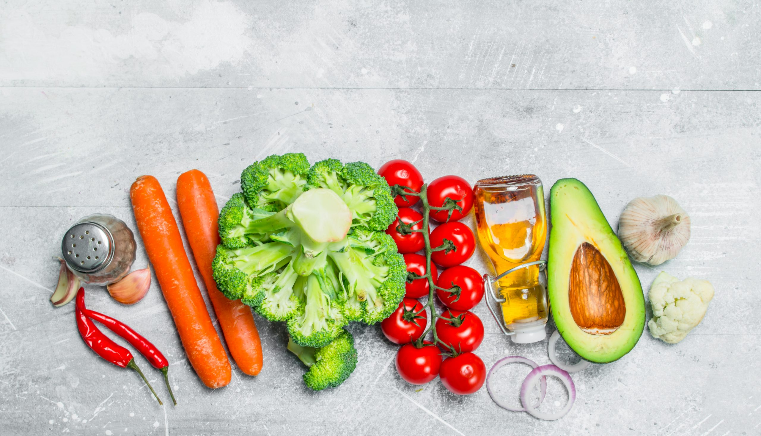 Organic food. Assortment of healthy vegetables . On a rustic background.